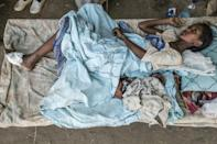 A girl recovers from her wounds at her house in Humera