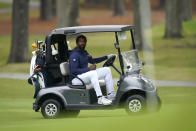 North Carolina A&T's J.R. Smith looks at his ball while driving a cart during the first round of the Phoenix Invitational golf tournament in Burlington, N.C., Monday, Oct. 11, 2021. Smith, who spent 16 years in the NBA made his college golfing debut in the tournament hosted by Elon. (AP Photo/Gerry Broome)