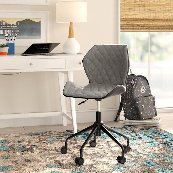 """<h2>Wrought Studio Warminster Task Chair</h2><br>The Warminster Task Chair is ready to give your home office a style upgrade without destroying your budget. Its contemporary style and diamond-tufted details make it the perfect accent to a workspace in need of a little pizzazz. <br><br><strong>The Hype</strong>: 4.6 out of 5 stars and 3,060 reviews<br><br><strong>WFH Pros Say:</strong> """"Easily upgraded my home office with this beauty! Stylish, comfortable, and affordable! The perfect package. I love how smoothly this chair rolls across my wood floors.""""<br><br><em>Shop</em> <strong><em><a href=""""https://www.wayfair.com/brand/bnd/wrought-studio-b36987.html"""" rel=""""nofollow noopener"""" target=""""_blank"""" data-ylk=""""slk:Wrought Studio"""" class=""""link rapid-noclick-resp"""">Wrought Studio</a></em></strong><br><br><strong>Wrought Studio</strong> Warminster Task Chair, $, available at <a href=""""https://go.skimresources.com/?id=30283X879131&url=https%3A%2F%2Fwww.wayfair.com%2Ffurniture%2Fpdp%2Fwrought-studio-warminster-task-chair-wrse1176.html"""" rel=""""nofollow noopener"""" target=""""_blank"""" data-ylk=""""slk:Wayfair"""" class=""""link rapid-noclick-resp"""">Wayfair</a>"""