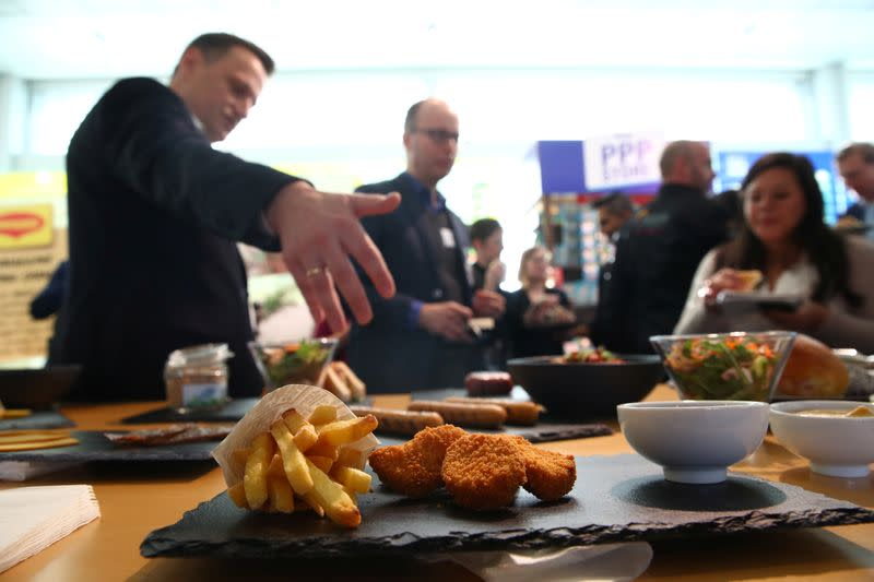 Palzer Chief Technology Officer gestures in front of plant based vegetarian dishes during a media presentation at Nestle in Vevey