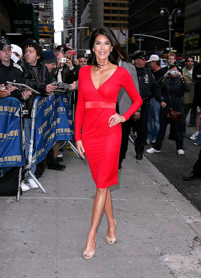 "Teri Hatcher arrives at the Ed Sullivan Theater for a taping of ""Late Show With David Letterman."" The ""Desperate Housewives"" star sizzles in a belted red dress and nude peep-toes. James Devaney/<a href=""http://www.wireimage.com"" target=""new"">WireImage.com</a> - May 12, 2008"