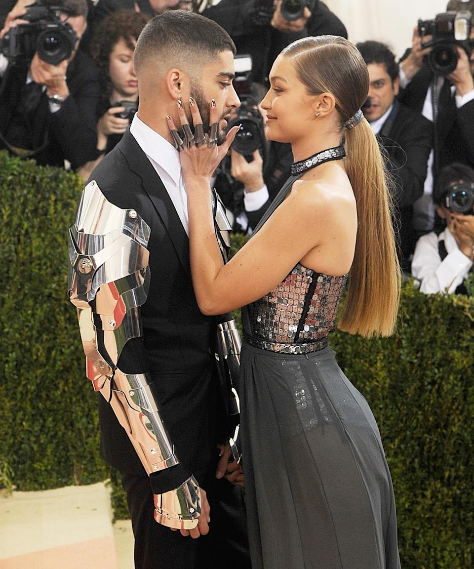 """Gigi had entered into a <em>very</em> public <a href=""""https://www.refinery29.com/en-us/2016/03/106775/gigi-hadid-zayn-malik-relationship-haters"""" rel=""""nofollow noopener"""" target=""""_blank"""" data-ylk=""""slk:relationship with Zayn Malik"""" class=""""link rapid-noclick-resp"""">relationship with Zayn Malik</a> that same year. One of their first red carpet appearances together included the 2016 Met Gala — the same event where Hadid wore a back-grazing ponytail and <a href=""""https://www.refinery29.com/en-us/2016/05/109811/gigi-hadid-met-gala-manicure"""" rel=""""nofollow noopener"""" target=""""_blank"""" data-ylk=""""slk:$2,000 manicure"""" class=""""link rapid-noclick-resp"""">$2,000 manicure</a>. <span class=""""copyright"""">Photo: Rabbani and Solimene Photography/Getty Images.</span>"""