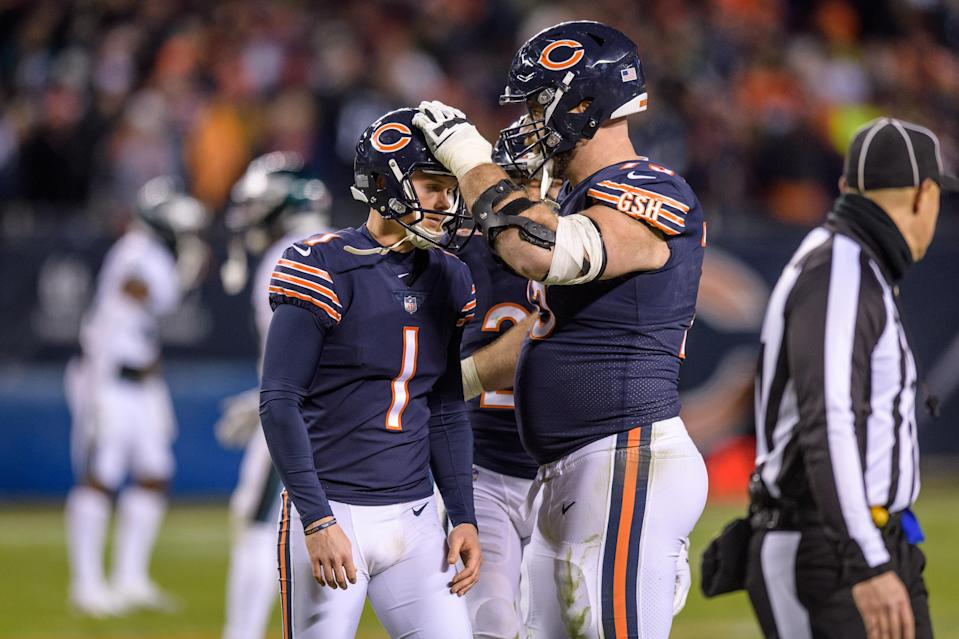 Kyle Long (R) tries to console Bears kicker Cody Parkey, who missed a 43-yard field goal as time expired, a kick that could've sent Chicago to Round 2 of the NFC playoffs. (Getty Images)