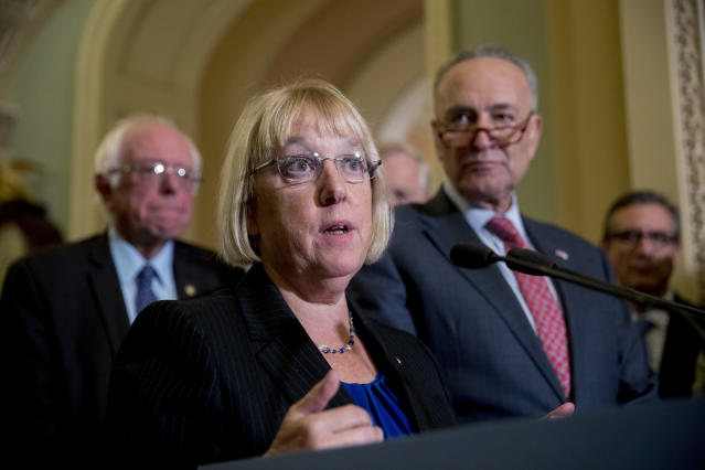 Sen. Patty Murray, flanked by Sen. Bernie Sanders and Senate Minority Leader Chuck Schumer, speaks to the press after she and Sen. Lamar Alexander reached a bipartisan deal to resume payments to health insurers that President Trump had blocked, Oct. 17, 2017. (Photo: Andrew Harnik/AP)
