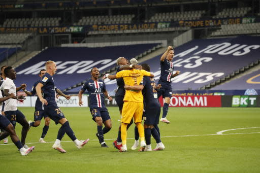 PSG's p[layers celebrate after winning the French League Cup soccer final match between Paris Saint Germain and Lyon at Stade de France stadium, in Saint Denis, north of Paris, Friday, July 31, 2020. (AP Photo/Francois Mori)