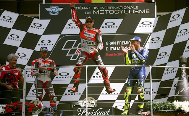 Motorcycling - MotoGP - Italian Grand Prix - Mugello Circuit, Scarperia, Italy - June 3, 2018 Ducati Team's Jorge Lorenzo (C) celebrates winning the race on the podium alongside runner up Ducati's Andrea Dovizioso (L) and third place Movistar Yamaha MotoGP's Valentino Rossi (R) REUTERS/Alessandro Bianchi