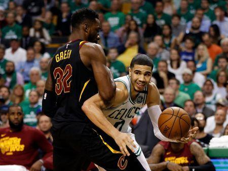 May 23, 2018; Boston, MA, USA; Boston Celtics forward Jayson Tatum (0) drives against Cleveland Cavaliers forward Jeff Green (32) during the third quarter of game five of the Eastern conference finals of the 2018 NBA Playoffs at TD Garden. Mandatory Credit: Greg M. Cooper-USA TODAY Sports