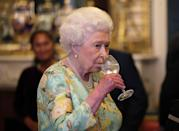 """<p>According to McGrady, alcohol is flowing throughout the family's two-day tradition fest. After church on Christmas day, he told <em><a href=""""https://www.dailymail.co.uk/news/article-5186803/What-Royals-REALLY-Sandringham-Christmas.html"""" rel=""""nofollow noopener"""" target=""""_blank"""" data-ylk=""""slk:The Daily Mail"""" class=""""link rapid-noclick-resp"""">The Daily Mail</a></em>, """"the Queen has a gin and Dubonnet, while Prince Philip has beer. Everyone else will sip a glass of Veuve Clicquot<em>."""" </em>At Christmas dinner, he says, """"the Queen enjoys drinking Gewurztraminer, an aromatic white wine.<em>""""</em></p>"""