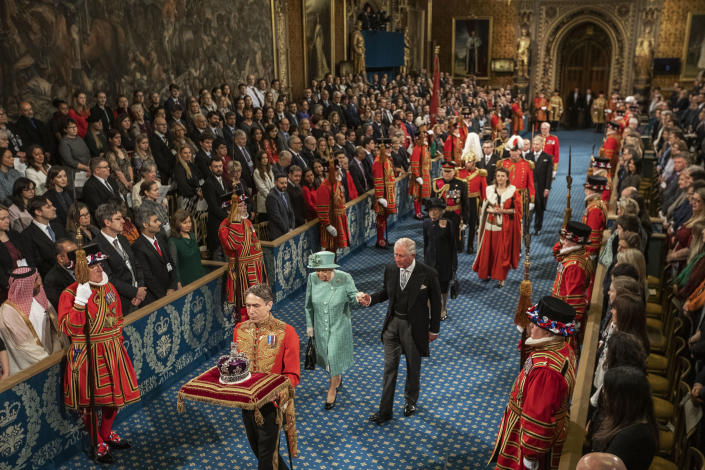 LONDON, ENGLAND - DECEMBER 19: Queen Elizabeth II and Prince Charles, Prince of Wales proceed through the Royal Gallery on their way to the Lord's Chamber to attend the State Opening of Parliament on December 19, 2019 in London, England. In the second Queen's speech in two months, Queen Elizabeth II unveiled the majority Conservative government's legislative programme to Members of Parliament and Peers in The House of Lords.  (Photo by Jack Hill - WPA Pool/Getty Images)