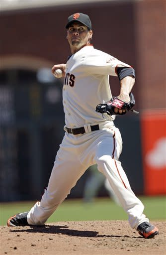 San Francisco Giants starting pitcher Ryan Vogelsong throws to the Texas Rangers during the third inning of a baseball game in San Francisco, Saturday, June 9, 2012. (AP Photo/Marcio Jose Sanchez)
