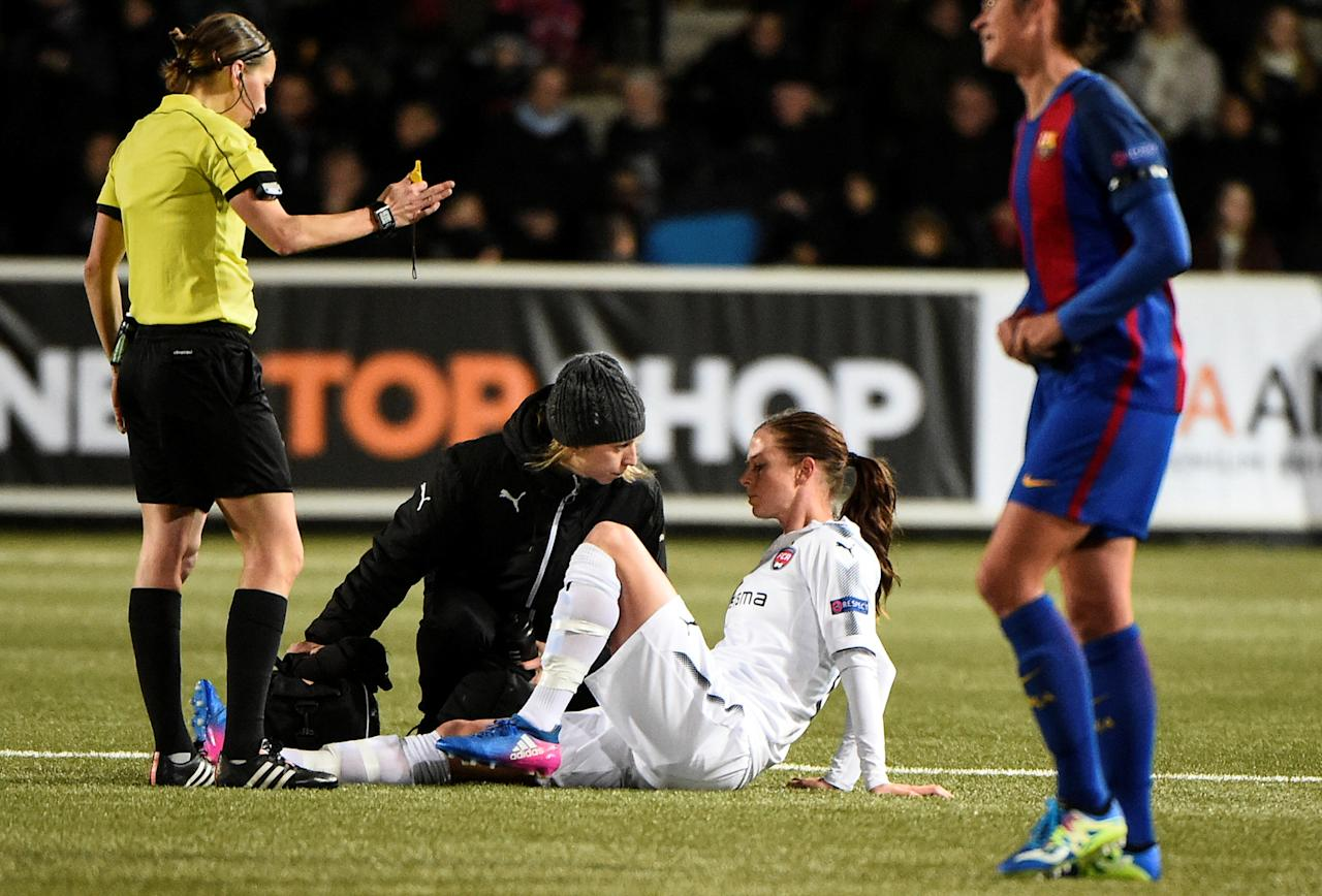 Football Soccer - FC Rosengard v FC Barcelona - UEFA Women's Champions League 1st Quarterfinal Match - Malmo IP Arena, Malmo, Sweden - 22/3/17 Rosengard's Lotta Schelin lays injured on the field. TT NEWS AGENCY/Emil Langvad/via REUTERS ATTENTION EDITORS - THIS IMAGE WAS PROVIDED BY A THIRD PARTY. FOR EDITORIAL USE ONLY. SWEDEN OUT. NO COMMERCIAL OR EDITORIAL SALES IN SWEDEN