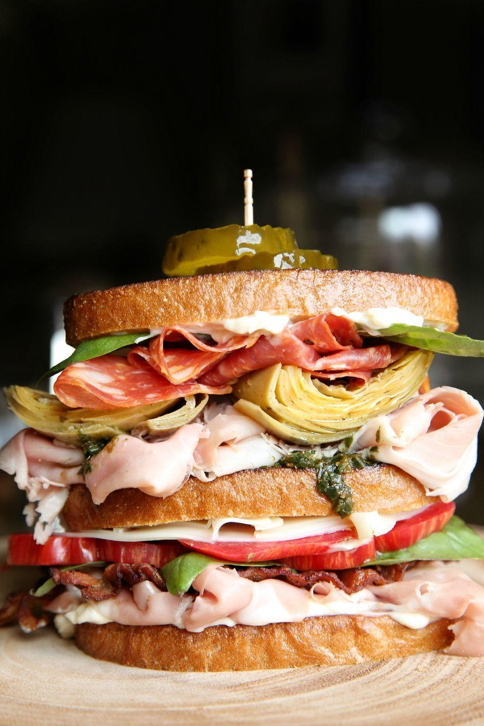 """<p>Stack up all the components of an antipasto platter for a sandwich that's <em>molto bene</em>.</p><p>Get the recipe from <a href=""""https://www.delish.com/cooking/recipe-ideas/recipes/a48559/italian-club-recipe/"""" rel=""""nofollow noopener"""" target=""""_blank"""" data-ylk=""""slk:Delish."""" class=""""link rapid-noclick-resp"""">Delish.</a></p>"""
