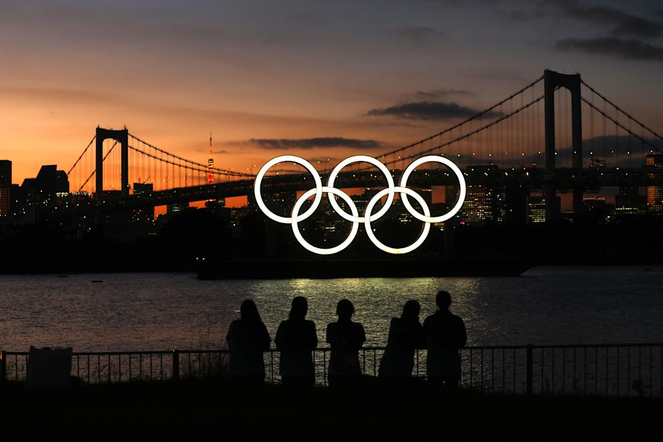 <p>TOKYO, JAPAN - AUGUST 04: A general view of the Olympic rings installation and Rainbow Bridge as the sun sets on day twelve of the Tokyo 2020 Olympic Games at Odaiba Marine Park on August 04, 2021 in Tokyo, Japan. (Photo by Clive Rose/Getty Images)</p>