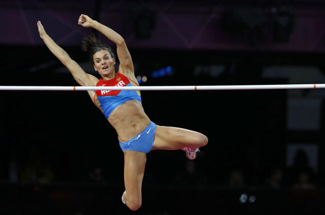 Russia's Yelena Isinbayeva clears the bar during the women's pole vault final at the London 2012 Olympic Games at the Olympic Stadium August 6, 2012. REUTERS/Phil Noble (BRITAIN - Tags: SPORT ATHLETICS OLYMPICS TPX IMAGES OF THE DAY)
