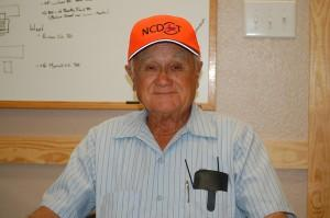 Old office worker. With an orange hat!