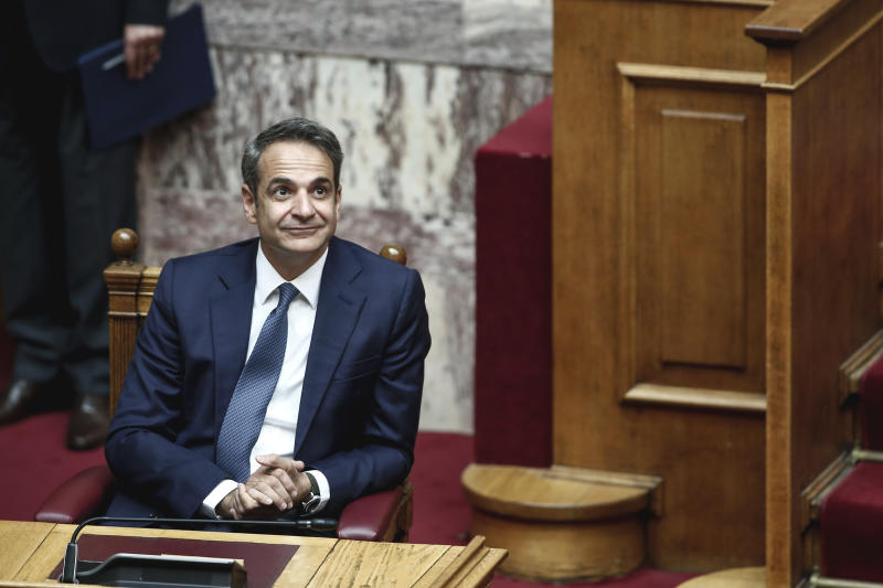 Greek Prime Minister Kyriakos Mitsotakis, attends a swearing in ceremony at the parliament in Athens, Wednesday, July 17, 2019. Greece held its first parliamentary session after the general elections held on July 7. (AP Photo/Yorgos Karahalis)