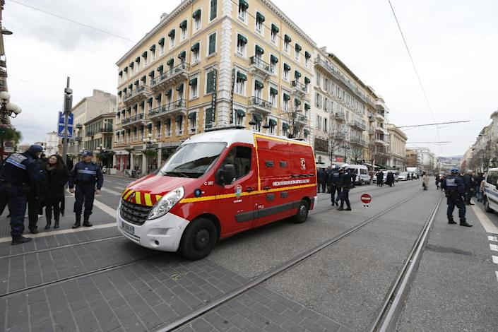 An Emergency Services vehicle drives near the Jewish Community Center where three soldiers were attacked by a man with a knife, on February 3, 2015 in downtown Nice (AFP Photo/Valery Hache)