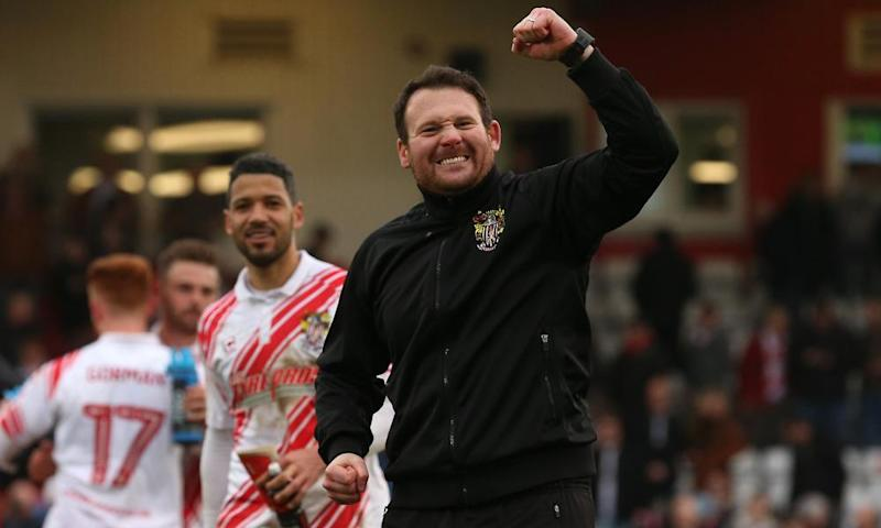 Stevenage manager Darren Sarll celebrates his side's crucial win over Portsmouth.