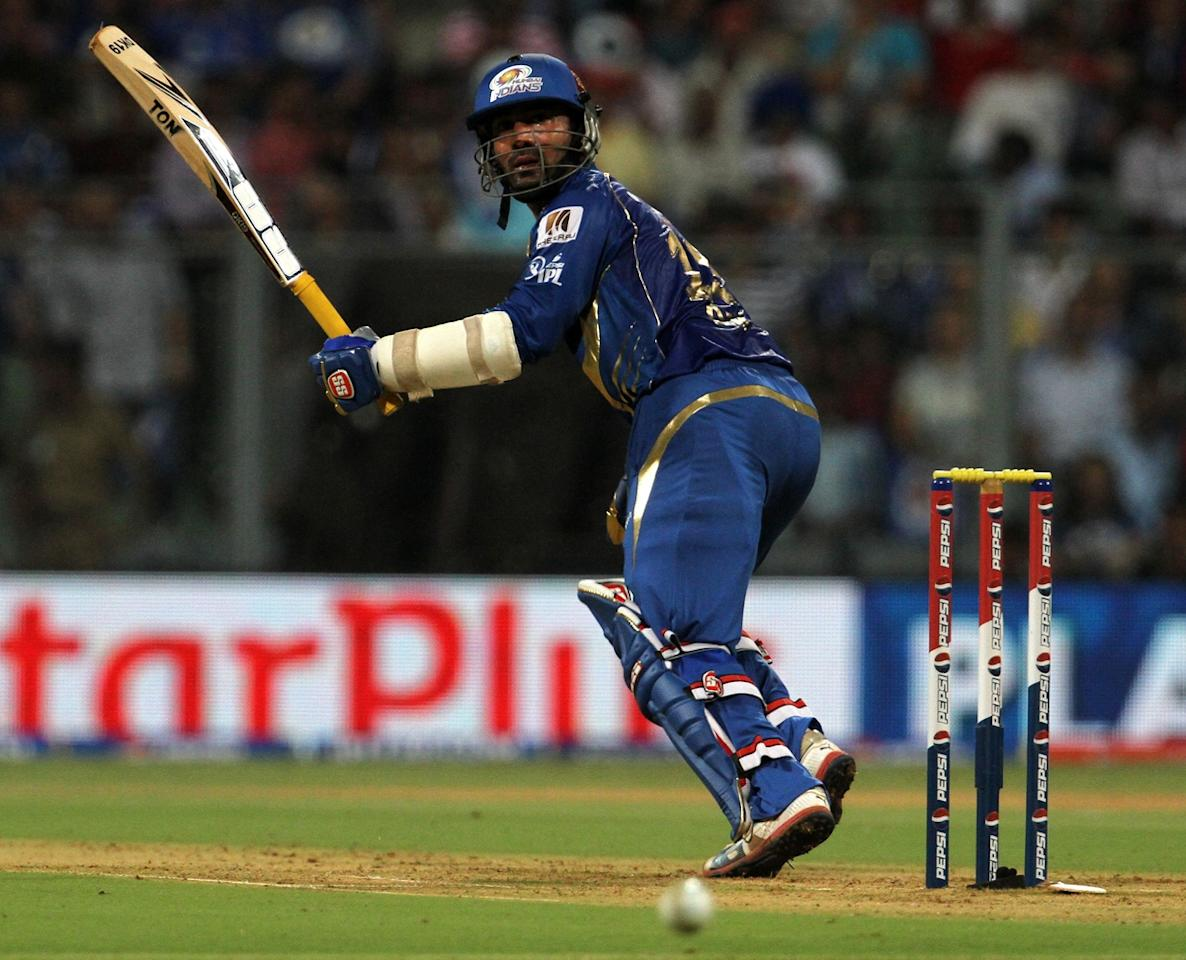 Mumbai Indian player Dinesh Karthik plays a shot during match 10 of the Pepsi Indian Premier League ( IPL) 2013  between The Mumbai Indians and the Delhi Daredevils held at the Wankhede Stadium in Mumbai on the 9th April 2013 ..Photo by Vipin Pawar-IPL-SPORTZPICS ..Use of this image is subject to the terms and conditions as outlined by the BCCI. These terms can be found by following this link:..https://ec.yimg.com/ec?url=http%3a%2f%2fwww.sportzpics.co.za%2fimage%2fI0000SoRagM2cIEc&t=1506344970&sig=gu8dviuIWbPDU28g1eSGYQ--~D