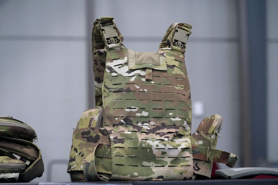 """The new """"modular scalable vest"""" is seen while members of the 82nd Airborne Division are issued the new body armor at Fort Bragg, N.C., Wednesday, Sept. 22, 2021. The Army for the first time, began handing out armor that now comes in three additional sizes, and can be adjusted in multiple ways to fit better and allow soldiers to move faster and more freely. The so-called """"modular, scalable vest"""" was is being distributed to soldiers at Fort Bragg, N.C., along with new versions of the combat shirt that are tailored to better fit women, with shorter sleeves and a flare at the bottom where it hits their hips. (AP Photo/Gerry Broome)"""