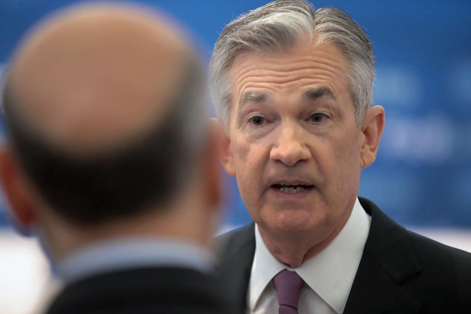 CHICAGO, ILLINOIS - JUNE 04: Jerome Powell (R), Chair, Board of Governors of the Federal Reserve speaks to former chair Ben Bernanke during a conference at the Federal Reserve Bank of Chicago on June 04, 2019 in Chicago, Illinois. The conference was held to discuss monetary policy strategy, tools and communication practices.  (Photo by Scott Olson/Getty Images)
