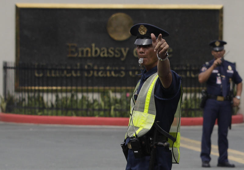 A security detail directs traffic in front of the U.S. Embassy in Manila, Philippines on Thursday Sept. 13, 2012. Manila police tightened security in the area following an attack that killed the U.S. ambassador and three other Americans in Libya. (AP Photo/Aaron Favila)