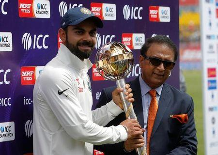 Cricket - India v Australia - Fourth Test cricket match - Himachal Pradesh Cricket Association Stadium, Dharamsala, India - 28/03/17 - India's Virat Kohli receives the ICC Test Mace from former Indian cricket player Sunil Gavaskar (R) after India won the test series against Australia. REUTERS/Adnan Abidi