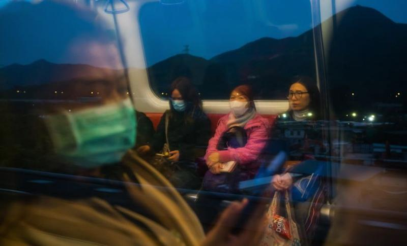 Some people ride the MTR train in Hong Kong wearing masks. Billy HC Kwok © 2020 The New York Times