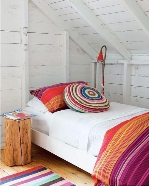 """<div class=""""caption-credit""""> Photo by: Stacey Branford, HouseandHome.com</div><b>Bright Bedding</b> <br> Since your bed tends to take up most of your room, choose a bright bedspread in a pattern you love. Nothing cheers up a space more than bright colors and mixing them up a bit."""