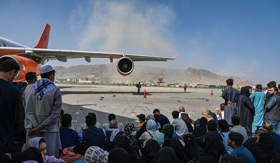 Afghan people waiting to board a plane at the Kabul airport on Monday. Thousands mobbed the airport trying to flee the Taliban's return. Photo: AFP via Getty Images/TNS