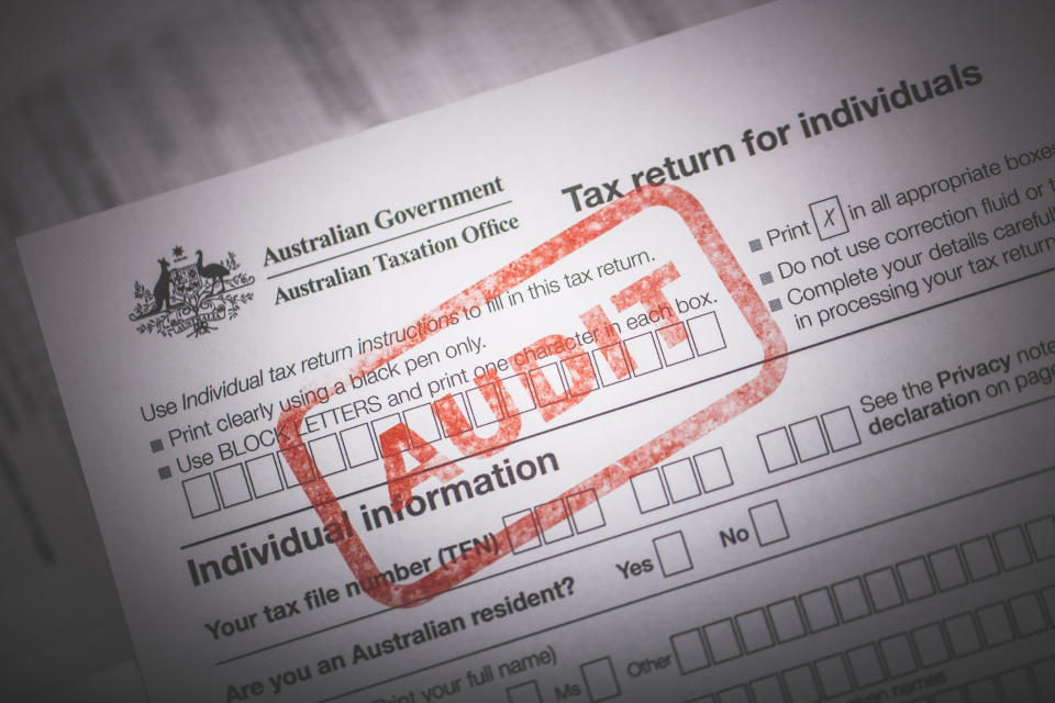 An editorial stock photo of the Australian Government Taxation forms with a red AUDIT ink stamp to illustrate Tax Audits or other Tax related themes.