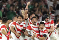 Japan's players celebrate after winning over Ireland during the Rugby World Cup Pool A game at Shizuoka Stadium Ecopa between Japan and Ireland in Shizuoka, Japan, Saturday, Sept. 28, 2019. (AP Photo/Eugene Hoshiko)