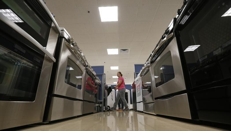 A woman walks by stoves in the appliance section at a Sears store in Schaumburg, Illinois near Chicago