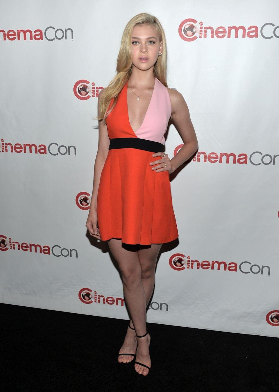 <p>For the red carpet the actor wore an orange and light pink panelled halterneck top with a black belt detail around the waist. </p>