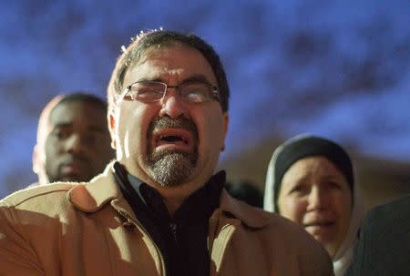 Namee Barakat, father of shooting victim Deah Shaddy Barakat, cries as a video is played during a vigil on the campus of the University of North Carolina in Chapel Hill, North Carolina February 11, 2015.  REUTERS/Chris Keane