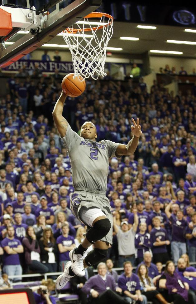 Kansas State guard Marcus Foster (2) dunks against Texas during the second half of an NCAA college basketball game Saturday, Feb. 8, 2014, in Manhattan, Kan. (AP Photo/The Wichita Eagle, Bo Rader)