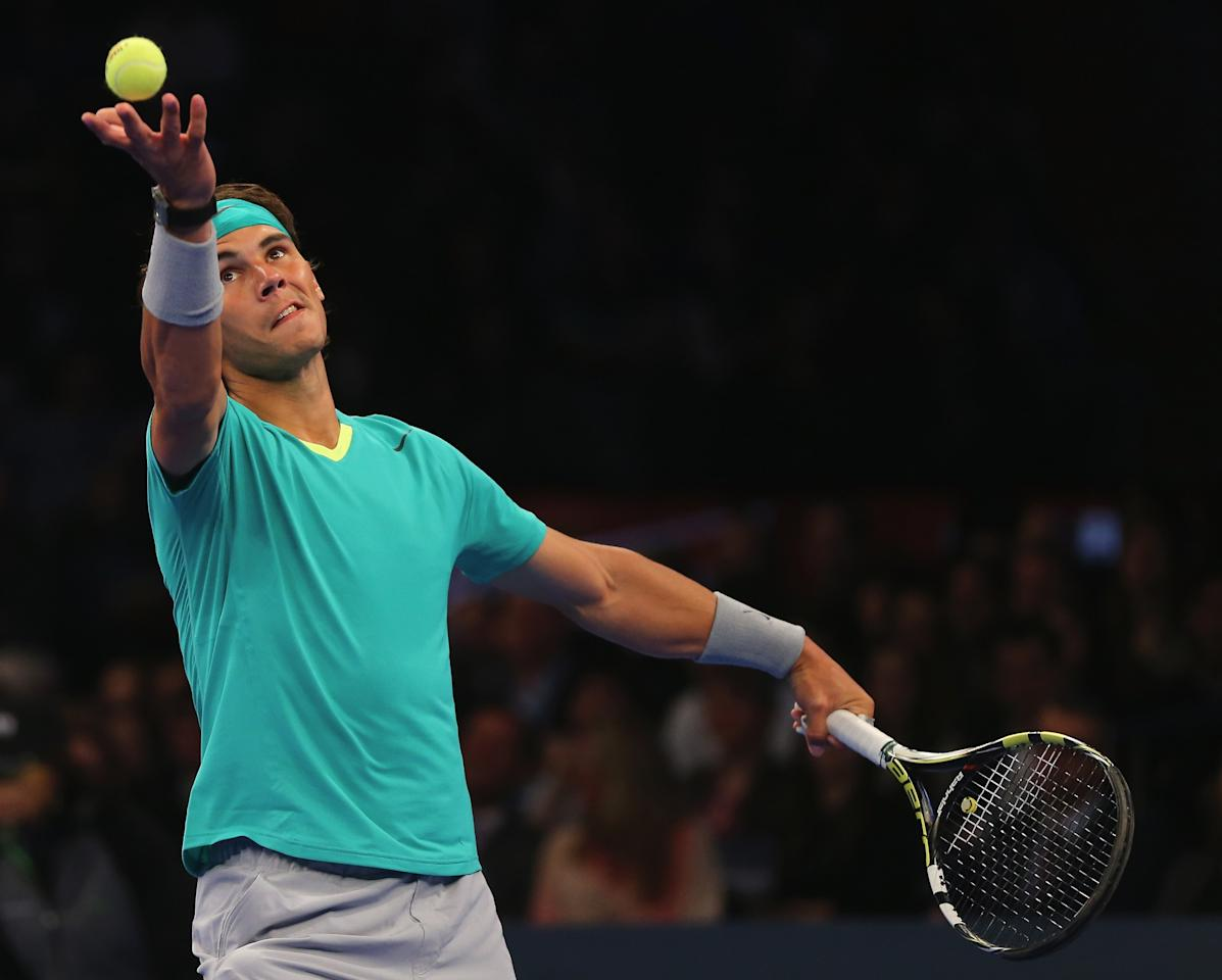 NEW YORK, NY - MARCH 04:  Rafael Nadal of Spain serves the ball to Juan del Potro of Argentina during the BNP Paribas Showdown on March 4, 2013 at Madison Square Garden in New York City.  (Photo by Elsa/Getty Images)