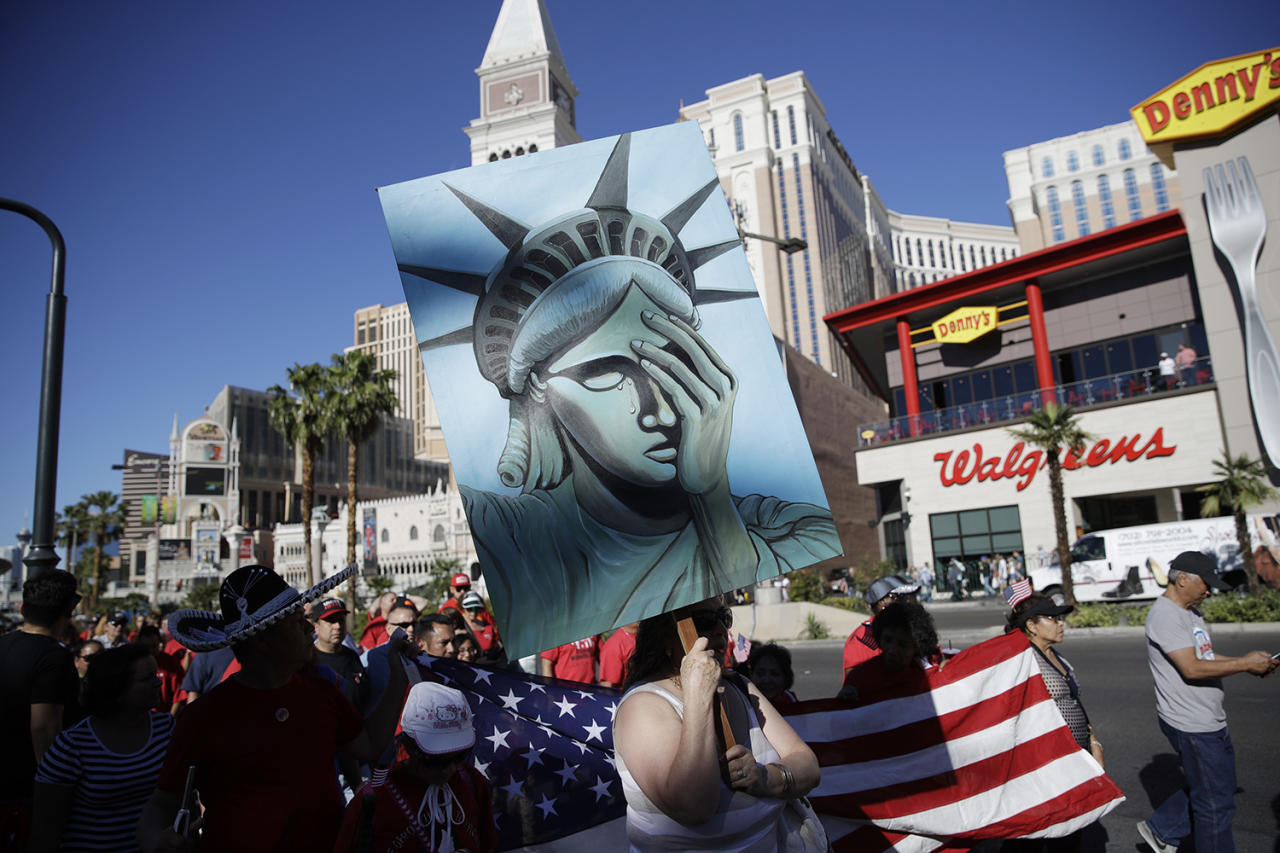 <p>People march along the Las Vegas Strip during a May Day rally, Monday, May 1, 2017, in Las Vegas. Union members and activists marched along and near the Las Vegas Strip to highlight immigration issues and push back against Trump administration policies. (John Locher/AP) </p>