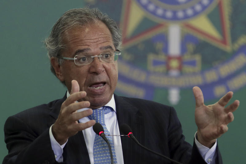 Brazil's Economy Minister Paulo Guedes speaks during a ceremony where the country's government bank presidents are to be presented at Planalto presidential palace in Brasilia, Brazil, Monday, Jan. 7, 2019. (AP Photo/Eraldo Peres)