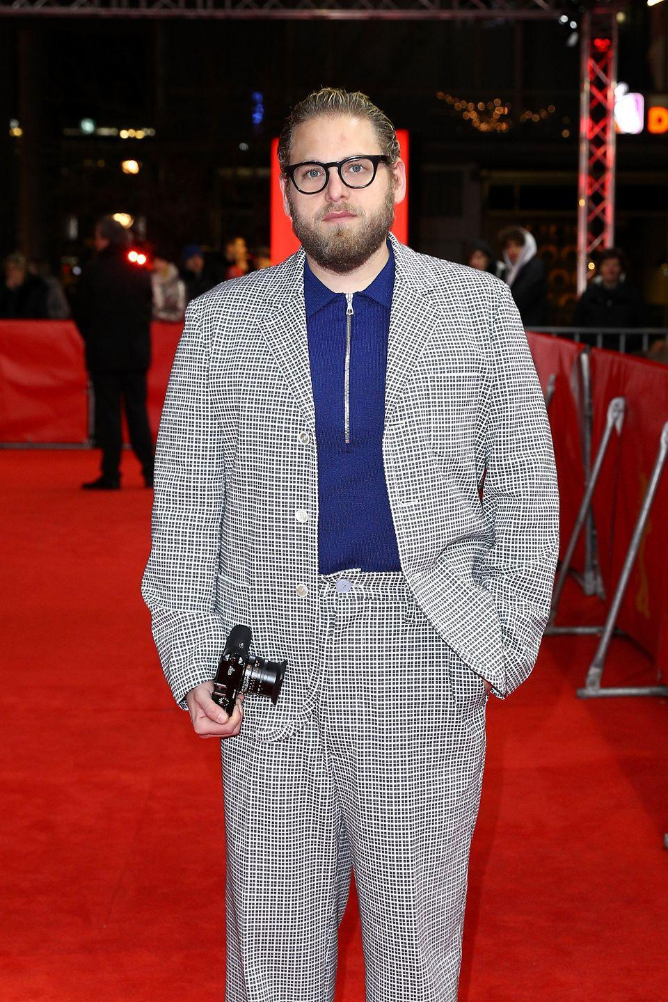 """<p>Another glasses-wearer outside of his films, and the <a href=""""https://www.menshealth.com/entertainment/a32585488/jonah-hill-most-swear-words/"""" rel=""""nofollow noopener"""" target=""""_blank"""" data-ylk=""""slk:actor"""" class=""""link rapid-noclick-resp"""">actor</a> looks awesome in a simple pair when paired with a patterned ensemble. </p>"""