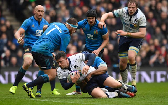 <span>Matt Scott of Scotland is hauled down by the Italy defence</span> <span>Credit: GETTY </span>