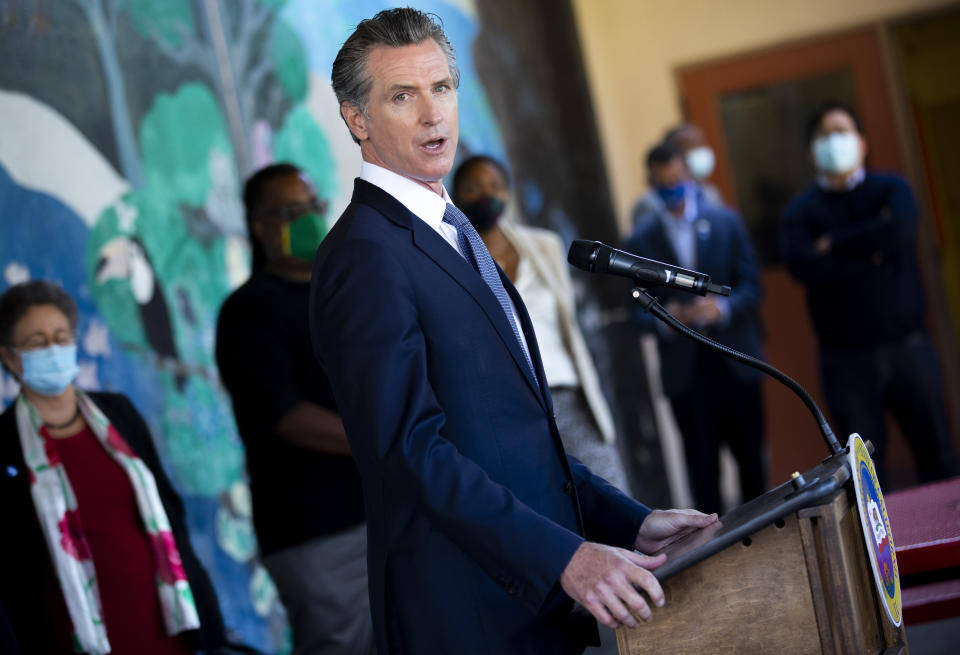 FILE - In this Aug. 11, 2021, file photo, California Gov. Gavin Newsom speaks with reporters at Carl B. Munck Elementary School in Oakland, Calif. Newsom has sharpened his message in the recall's final month and is focusing his attention on conservative rival Larry Elder, who has pledged to end California's mask mandate. The last day to vote is Sept. 14. (Santiago Mejia/San Francisco Chronicle via AP, Pool, File)
