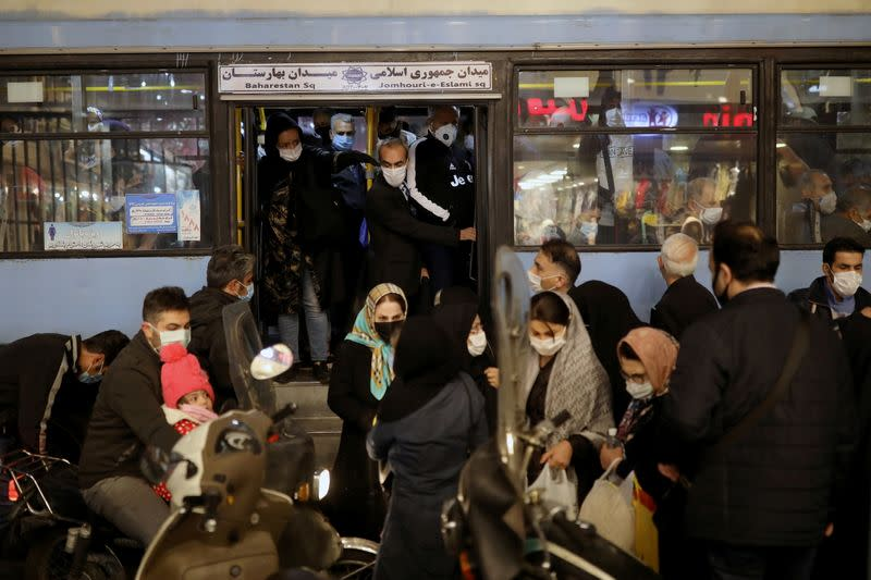 Iranian People wearing protective masks are pictured at a bus, amid the outbreak of the coronavirus disease (COVID-19), in Tehran