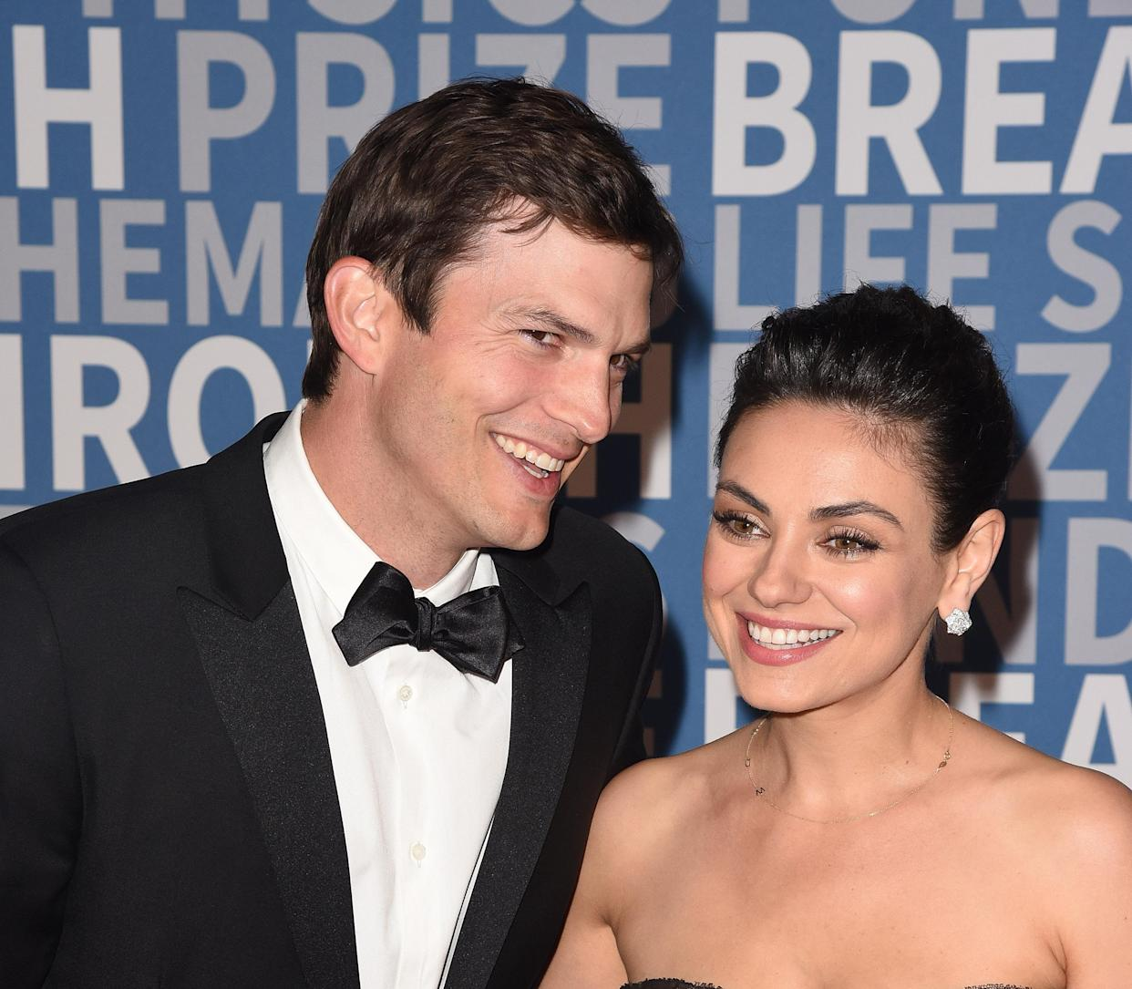 MOUNTAIN VIEW, CA - DECEMBER 03:  Actors Ashton Kutcher (L) and Mila Kunis attend the 2018 Breakthrough Prize at NASA Ames Research Center on December 3, 2017 in Mountain View, California.  (Photo by C Flanigan/FilmMagic)