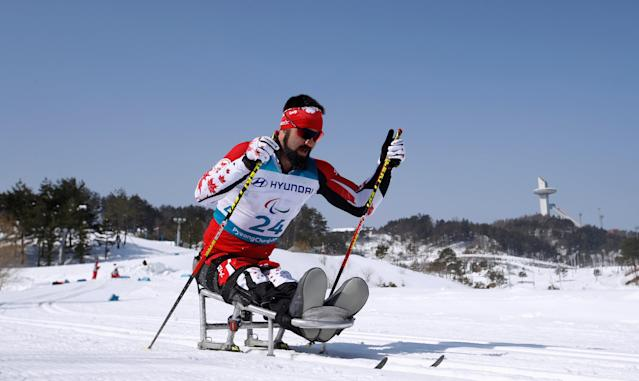 Cross-Country Skiing - Pyeongchang 2018 Winter Paralympics - Men's 15 KM - Sitting - Alpensia Biathlon Centre - Pyeongchang, South Korea - March 11, 2018 - Collin Cameron of Canada competes. REUTERS/Carl Recine