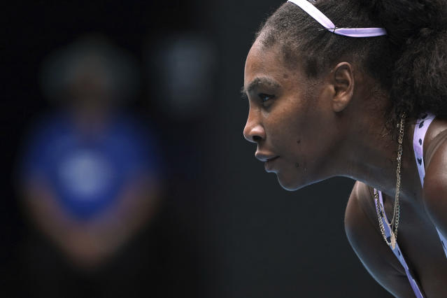 Serena Williams of the U.S. waits to receive serve from China's Wang Qiang in their third round singles match at the Australian Open tennis championship in Melbourne, Australia, Friday, Jan. 24, 2020. (AP Photo/Lee Jin-man)