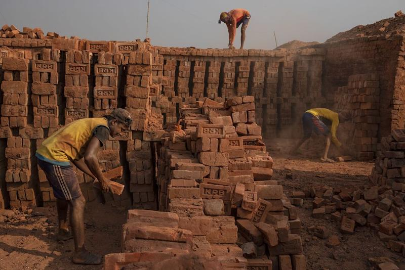 At a kiln outside Kutupalong camp, Rohingya refugees are employed for work that Bangladeshis won't do. | James Nachtwey for TIME