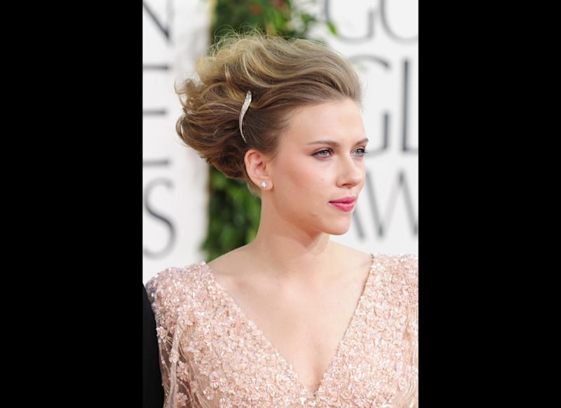 Actress Scarlett Johansson arrives on the red carpet for the 68th annual Golden Globe awards at the Beverly Hilton Hotel in Beverly Hills, California January 16, 2011. AFP PHOTO / Robyn Beck (Photo credit should read ROBYN BECK/AFP/Getty Images)