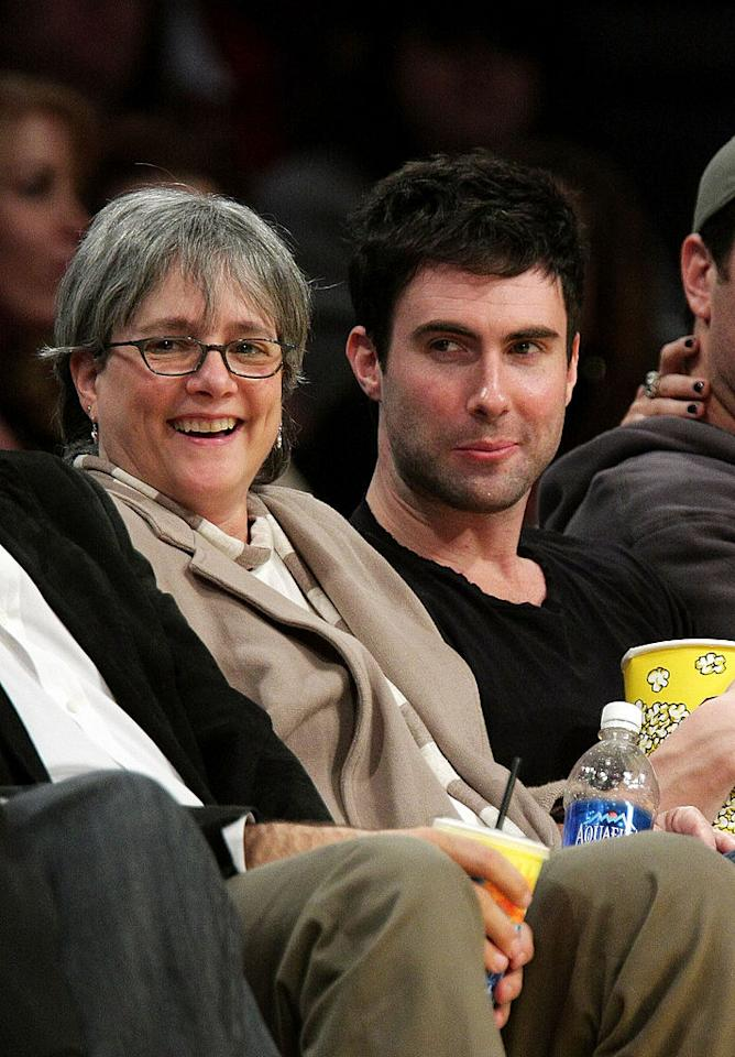 <p>Adam Levine (R) and his mother Patsy Noah (L) attend the Los Angeles Lakers vs Oklahoma City Thunder game at the Staples Center on February 10, 2009 in Los Angeles, California. </p>