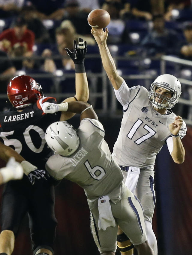 Nevada quarterback Cody Fajardo (17) fires a pass over San Diego State linebacker Derek Largent during the second quarter of an NCAA college football game on Friday, Oct. 4, 2013, in San Diego. (AP Photo/Lenny Ignelzi)